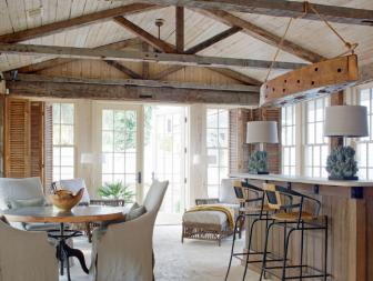 Neutral Coastal Great Room With Exposed-Beam Ceiling