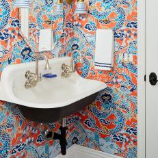 Blue and Orange Bathroom With Wallpaper