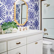 Blue and White Bathroom With Graphic Wallpaper