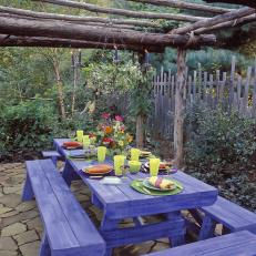 Purple Outdoor Dining Table and Pergola