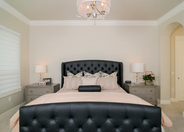 Bedroom With Black Upholstered Bed