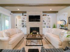 Neutral Transitional Living Room With Stone Fireplace Surround