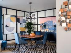 A formal entertaining space infused with chic modern elements, the dining room opens out to the great room, with graphic wall coverings that elevate the design.