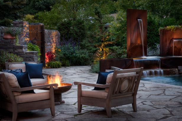 Cozy Patio With Cushioned Seating, Fire Pit and Water Feature