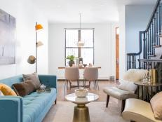 Designer Joe Human updated this historic 1800s townhouse in Harlem with a subtle blue and yellow palette, strategically placed light fixtures and unique accents. The result is a stylish space that's apt for modern living.