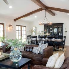 Open Concept Living Space With Exposed Beam Vaulted Ceiling