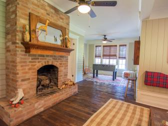 Brown Rustic Family Room with Brick Fireplace and Custom Mantel