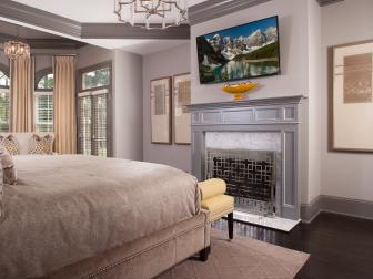 Gold and Silver Bedroom With Fireplace