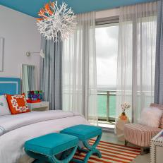 tropical bedrooms. Blue and White Tropical Bedroom With Orange Pillows Photos  HGTV