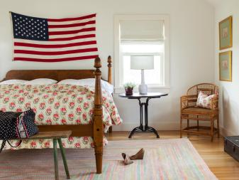 Contemporary Guest Room With Four-Post Bed and American Flag