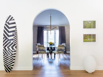 Doorway Draws Playful Contrast to Elegant Dining Room