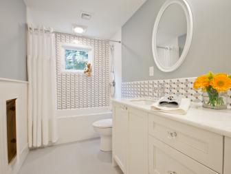 Gray Bathroom With Mosaic-Tiled Backsplash and Tub Surround