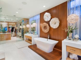 Spa Bathroom With Wood Accent Wall and Modern Standalone Tub