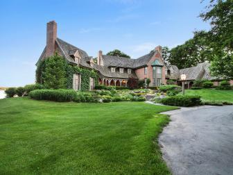 Tudor Manor With Lush Front Lawn and Landscaping