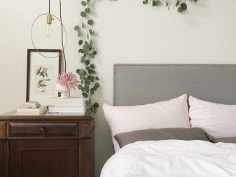 Bedroom With Eucalyptus Garland Above Headboard