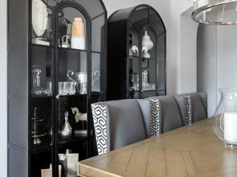 Transitional Dining Room With a Pair of Black Metal Cabinets