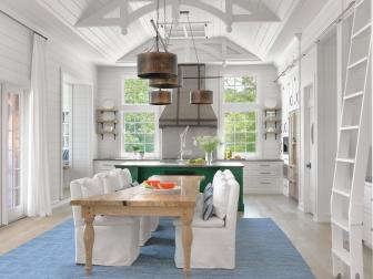 White Cottage Open Kitchen and Dining Room With Ladder
