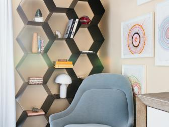 Sitting Area With Modern Chair and Hexagonal Shelf System