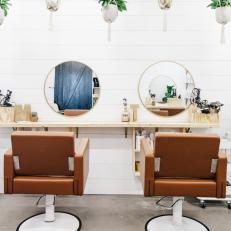 Gold Rimmed Mirrors Add Glamour to Neutral, Bohemian Hair Salon