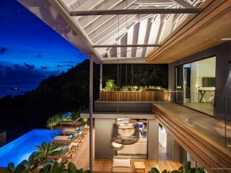 Covered Multilevel Deck With Pool in Evening