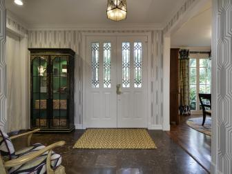 Foyer With White Door and Marble Flooring