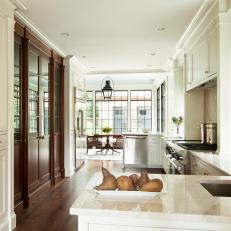 Mahogany Doors Separate Kitchen and Dining Room Spaces