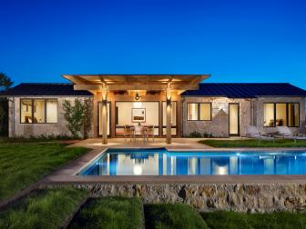 Back Exterior: Ranch Home With Pool at Night