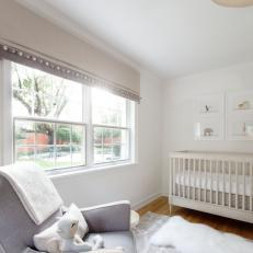 Neutral Transitional Nursery With Sheepskin
