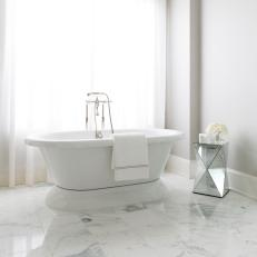 Free Standing Tub in Master Bathroom With Marble Tile Flooring