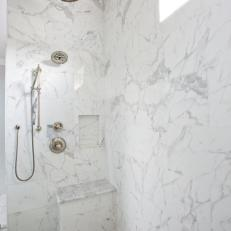 Standing Shower With Marble Tiling and a Frosted Glass Panel