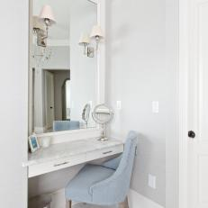 Vanity With Light Blue Chair in Master Bathroom
