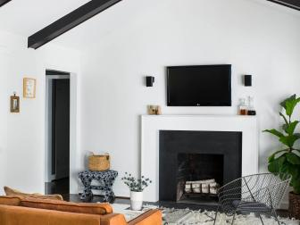 Black and White Mid-century Modern Living Room With Vault Ceiling