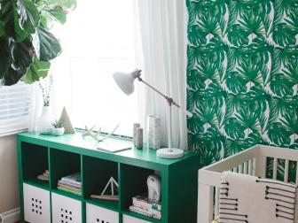 Green and White Tropical Nursery With Wallpaper