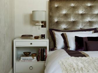 Gold and Purple Bedroom With Velvet Headboard