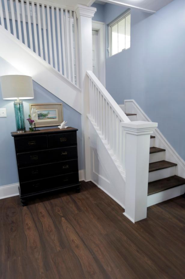 White Railed Staircase in Blue Foyer