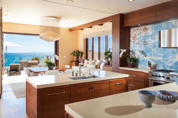 Island in Neutral Contemporary Kitchen With Custom Backsplash