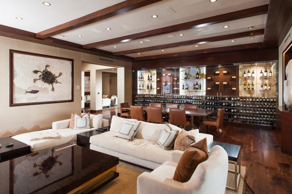 Neutral Contemporary Basement With Wall for Wine Storage
