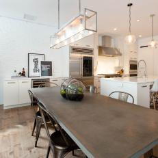White Open Plan Kitchen and Dining Table