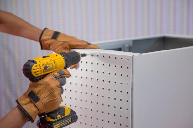 Drill the peg board to the side of the cabinet.