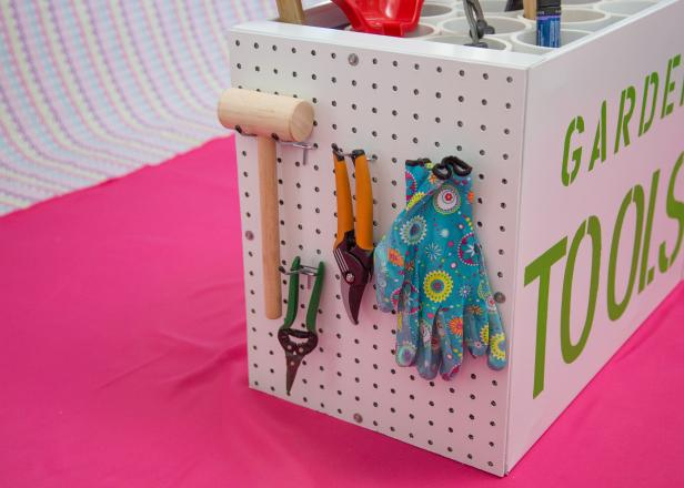 Hang tools to the pegboard on the side of the storage rack.