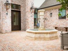 French Country Courtyard With Fountain
