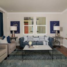 Living Room With Blue Sofa, Chevron Rug and Quatrefoil Mirror