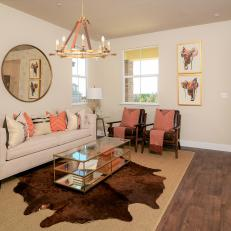 living room with wagon wheel chandelier and animal skin rug