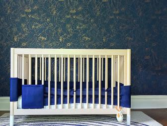 Modern Nursery with Copper and Blue Sea Wallpaper and White Crib