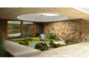 Contemporary Courtyard with Driftwood, Boulder and Stone