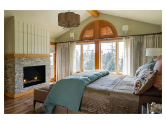 Green Rustic Bedroom With Stone Fireplace