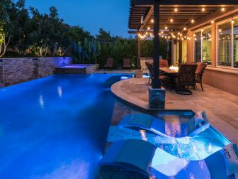 Landscape Lights Illuminate Pool at Night