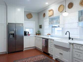Contemporary White Kitchen with Red Patterned Rug