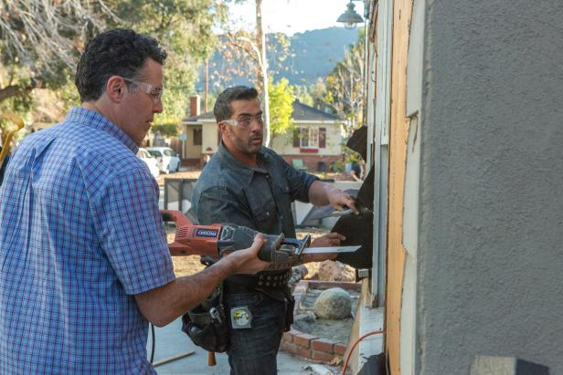 Skip Bedell and Adam Carolla Repairing Siding