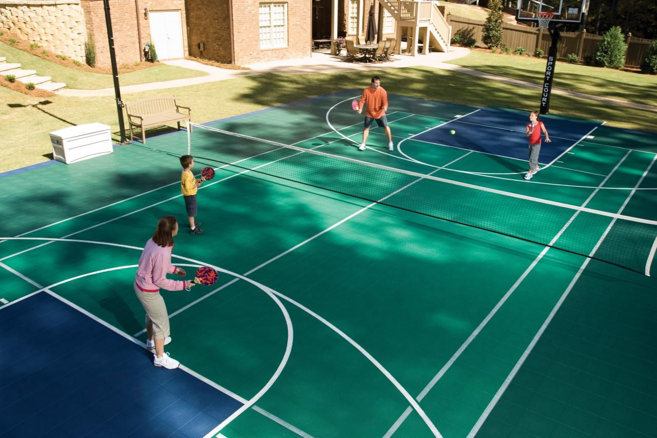 Bring the game home with a backyard sports court hgtv for Backyard sport court ideas